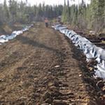 Guide : Routes d'accès et milieux humides : guide sur la planification, la construction et l'entretien